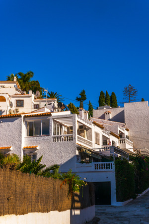 beautiful, picturesque street, narrow road, white facades of buildings, Spanish architecture, sunny day