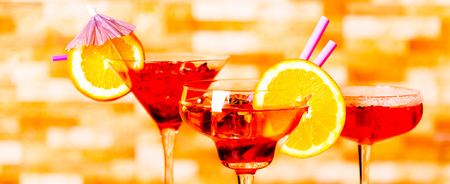 Tasty and colorful drinks based on various alcohols, syrups and liqueurs, unique effect of the bartenders work, party night Stock Photo