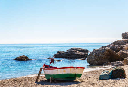 Old boat on the shore on the sand, vacation, beach for tourists, sunny day Archivio Fotografico