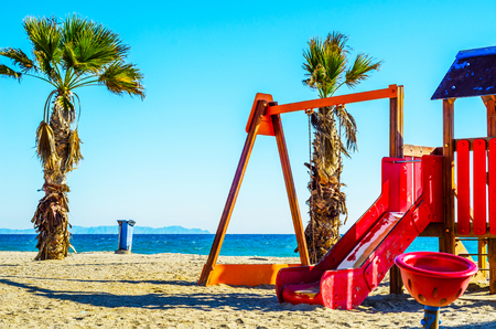 Colorful childrens Playground on the beach on a hot day, Playground for children near the sea, relax and fun