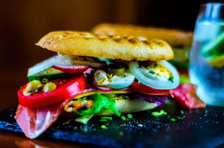 Mini grilled sandwich with various cold meats, cheese, mushrooms, tomato and egg, tasty and healthy snack, hot food