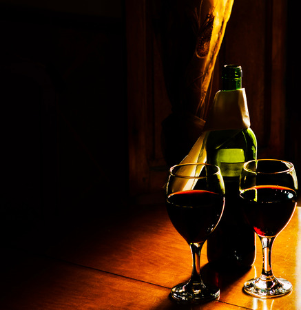 Red wine in a glass, celebration of a moment with a glass of wine, exquisite liquor for gourmets, winery