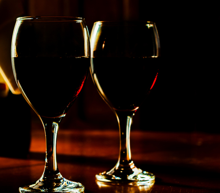 red wine in a glass, celebration of a moment with a glass of wine, exquisite liquor for gourmets, winery Standard-Bild