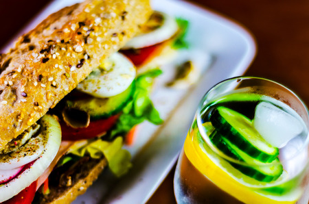 Whole grain sandwich with ham, tomato, mushrooms and egg, fresh organic vegetables, healthy food