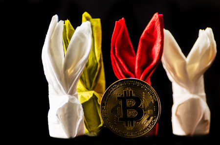 Crypto currency Gold Bitcoin, BTC, macro shot of Bitcoin coins with bunny napkin,  bitcoin and easter concept