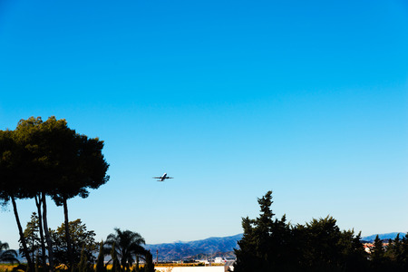 Passenger plane flying in the blue sky, cruise aircraft, transport industry, aviation