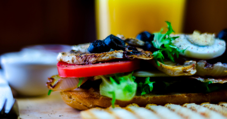 Grilled sandwich with various cold meats, cheese, mushrooms, tomato and egg, tasty and healthy snack, hot food Foto de archivo