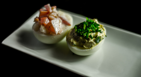 stuffed eggs with hand-made stuffing, healthy and tasty snack, easter