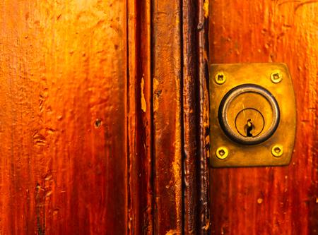 old door lock, aged wooden door, home security, vintage