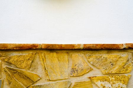 old stone placed in the wall, interesting and original background, solid wall Stock Photo