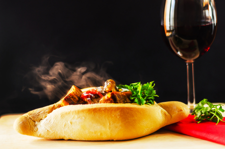 goulash with large pieces of meat and vegetables, all served in bread, attractive and satiating meal