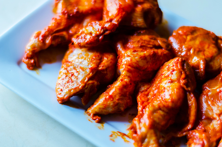 Chicken wings marinated in a barbecue sauce, a typical American snack, delicious food