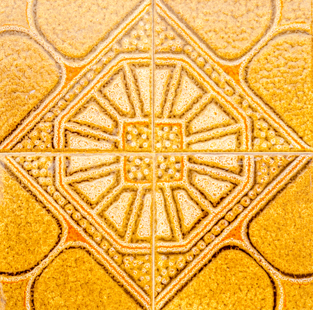 Traditional ornamental Spanish decorative tiles, original ceramic tiles on the walls of buildings, decoration