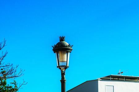 Old stylish street lamp illuminating the Spanish street, a characteristic element of traditional street architecture, decor
