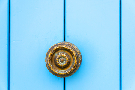 Close up on a round door handle with decorative elements, door decoration, vintage
