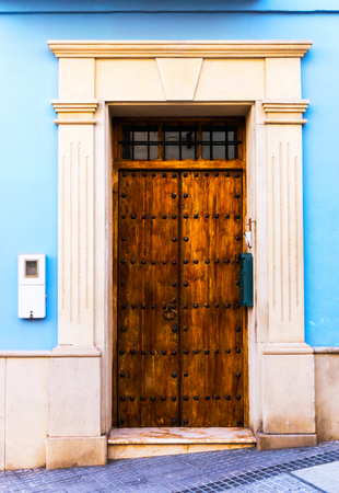 Old door with interesting texture, element of architecture, interesting entrance to the building, vintage style, entrance