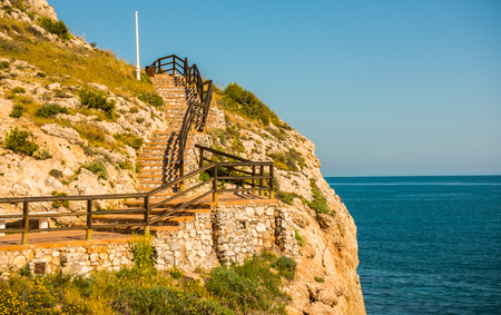 Wooden promenade along the sea coast situated on a cliff rock in Rincon de la Victoria, Costa del Sol, Andalucja, Spain