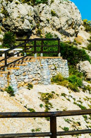 Wooden promenade along the sea coast situated on a cliff rock in Rincon de la Victoria, Costa del Sol, Andalucja, Spain