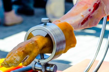 Leg jamon serrano prepared for slicing, traditional Spanish ham, meat