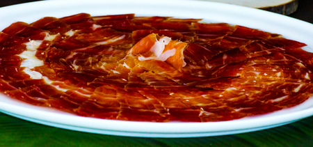 Plate with cut slices of jamon serrano, traditional Spanish ham, meat