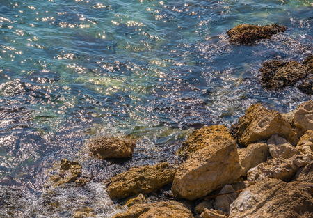 Amazing sea with blue summer wave and rocks, relaxing view of rocks and water, nature