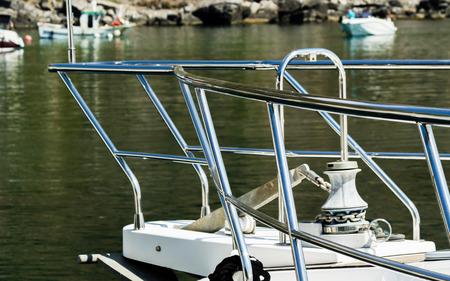 Closeup on elements of yachts and motor boats anchored in the harbor, hot day at harbor, marina Фото со стока