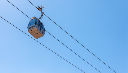 Cableway against the sky, transport at height and tourist attraction, travel Stock Photo