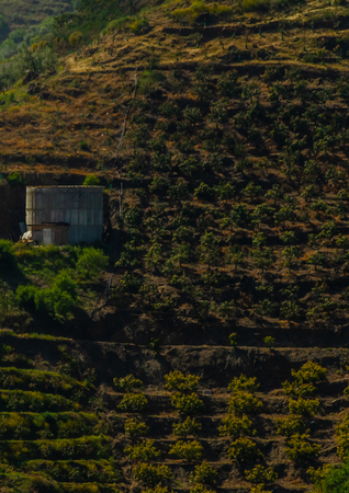 Concrete irrigation basin on high hills in Andalusia, a place of water storage in arid areas, agriculture Standard-Bild