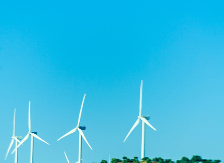 wind turbines generating electricity on blue sky, alternative energy source, environment Stock Photo