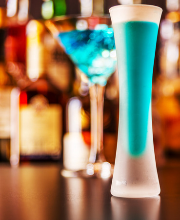 Refreshing liqueur in a tall glass, alcoholic drink prepared by the bartender, nightlife concept