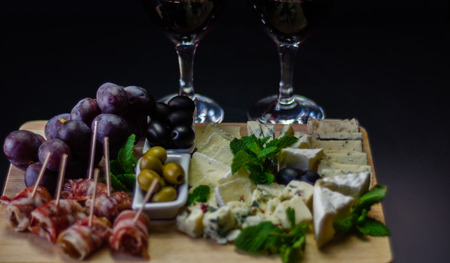 Set of different cheeses on a wooden board, cheese board, delicious snack, healthy and exclusive food, cheese set Stock fotó