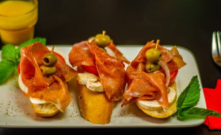 Traditional Spanish tapas for lunch table, mini sandwiches food set,  delicious snack appetizer,  food