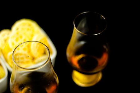 Glasses of whiskey with salty snacks on the background of the bar, party time Archivio Fotografico