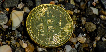 Crypto currency Gold Bitcoin, BTC, macro shot of Bitcoin coins on beach background,  bitcoin mining concept