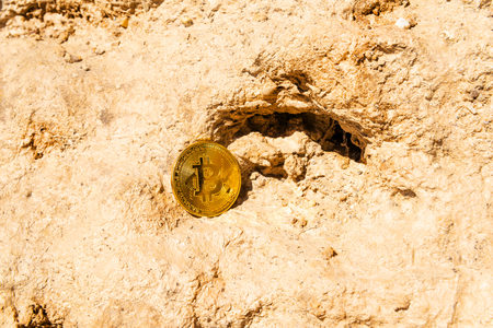 Crypto currency Gold Bitcoin, BTC, macro shot of Bitcoin coins on rock background,  bitcoin mining concept