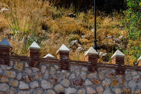 Typical Moorish defensive walls in a small town of Andalusia, a historic element of architecture, Spain Фото со стока