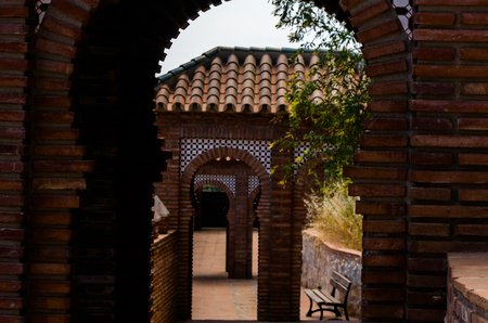 Typical Moorish defensive walls in a small town of Andalusia, a historic element of architecture, Spain 免版税图像