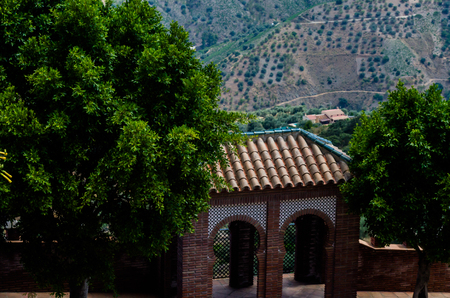 Typical Moorish defensive walls in a small town of Andalusia, a historic element of architecture, Spain Stock Photo