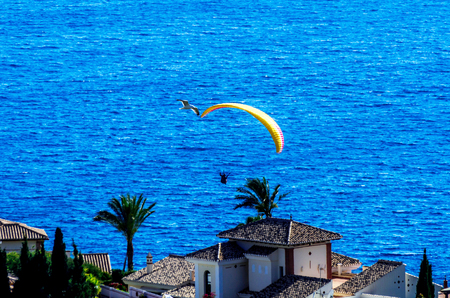 Paraglider flying in the sky free time spent actively wonderful experiences vacation, active sport Reklamní fotografie