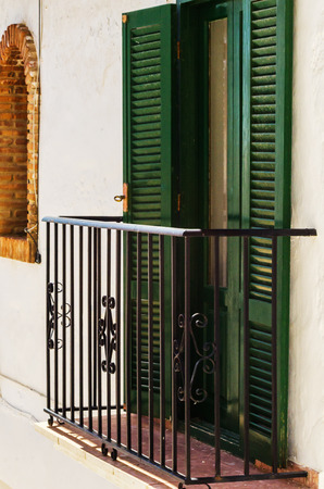 Stylish balcony with a metal railing solid architectural element a place of rest and relaxation vintage decor, balcony