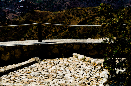 Tourist path in a mountainous Spanish town, a pedestrian trail secured with a rope, active rest