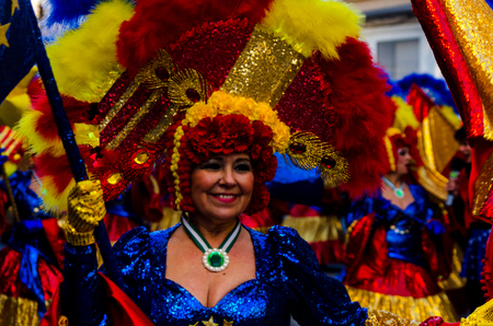 NERJA, SPAIN - FEBRUARY 10, 2018People in costumes celebrating carnival in Malaga province, carnival parade