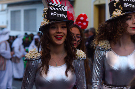 NERJA, SPAIN - FEBRUARY 10, 2018 People in costumes celebrating carnival in Malaga province, carnival parade