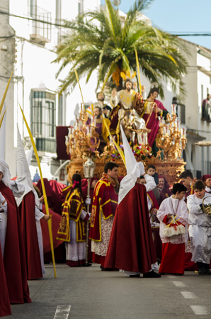VELEZ-MALAGA, SPAIN - MARCH 25, 2018 People participating in the procession  in the Holy Week in a Spanish city, easter