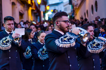 VELEZ-MALAGA, SPAIN - MARCH 24, 2018 People participating in the procession  in the Holy Week in a Spanish city, easter