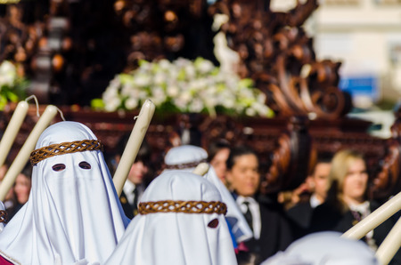 VELEZ-MALAGA, SPAIN - MARCH 27, 2018 People participating in the procession  in the Holy Week in a Spanish city, easter Editöryel