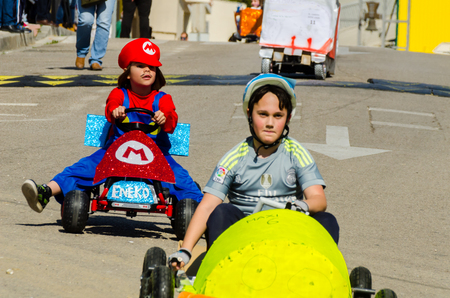 VELEZ-MALAGA, SPAIN - APRIL 14, 2018 Autos Locos - traditional fun involving the ride of cardboard cars, self-made vehicles, creative and cheerful event