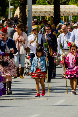 TORRE DEL MAR, SPAIN - APRIL 29, 2018 people participating in the celebration of the Catholic ceremony of transferring the holy figure in Spain