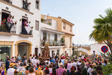 VELEZ MALAGA, SPAIN - MAY 19, 2018 people participating in the celebration of the Catholic ceremony of transferring the holy figure in Spain Sajtókép