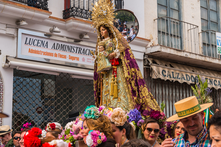 VELEZ MALAGA, SPAIN - MAY 19, 2018 people participating in the celebration of the Catholic ceremony of transferring the holy figure in Spain Editorial